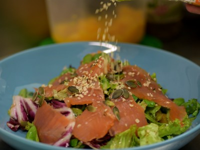 Fresh salmon, salad and sesame